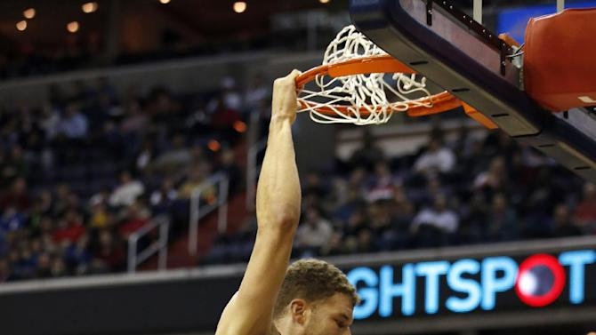 Los Angeles Clippers forward Blake Griffin (32) dunks the ball past Washington Wizards forward Jan Vesely (24), from The Czech Republic, and center Marcin Gortat (4), from Poland, in the first half of an NBA basketball game Saturday, Dec. 14, 2013, in Washington