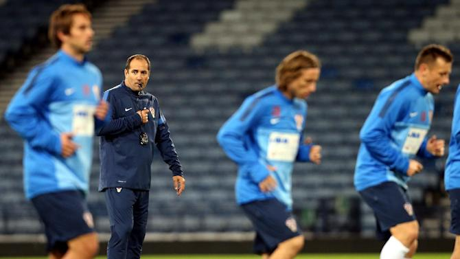 Croatia's manager Igor Stimac watches his squad during a team training session at Hampden Park, Glasgow, Scotland, Monday Oct. 14, 2013. Croatia face Scotland in a World Cup qualifying Group A  soccer match on Tuesday