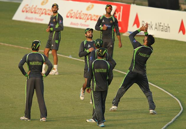 Pakistani cricket players take part in a practice session in Lahore, Pakistan, Wednesday, May 17, 2015. Pakistan and Zimbabwe will play the second one day international on Thursday. (AP Photo/K.M. Cha