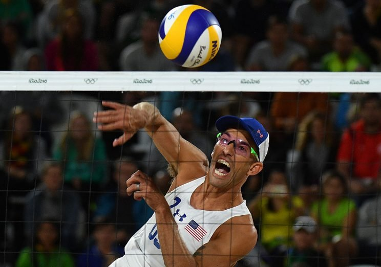 USA's Nicholas Lucena spikes the ball during the men's beach volleyball qualifying match between USA and Italy at the Beach Volley Arena in Rio de Janeiro on August 11, 2016, for the Rio 2016 Olympic Games. / AFP / Leon NEAL (Photo credit should read LEON NEAL/AFP/Getty Images)