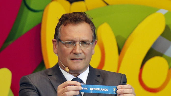"FIFA Secretary General Jerome Valcke holds the slip showing ""Netherlands"" during the draw for the 2014 World Cup at the Costa do Sauipe resort in Sao Joao da Mata"