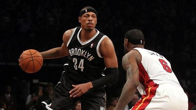 Basketball - Resilient Nets hold off James' Heat