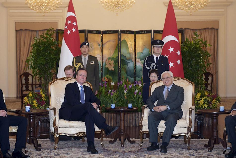 Britain's Prime Minister David Cameron meets with Singapore's President Tony Tan at the Istana in Singapore