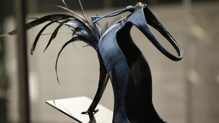 "This Feb. 11, 2013 photo shows Roger Vivier's Eyelash Heel pump displayed at the ""Shoe Obsession"" exhibit at The Museum at the Fashion Institute of Technology Museum in New York. The exhibition, showing off 153 specimens, runs through April 13. (AP Photo/Kathy Willens)"
