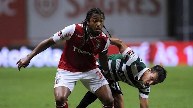 Sporting's Cedric Soares, right, challenges Sporting Braga's Alan Silva, from Brazil, during their Portuguese League soccer match at the Municipal Stadium, in Braga, Portugal, Saturday Sept. 26, 2013. Alan and Cedric scored once in Sporting's 2-1 victory