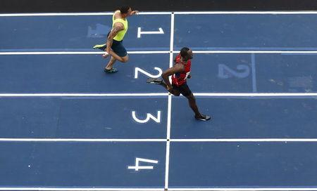 """Jamaican Olympic gold medallist Bolt runs against Bailey of the U.S. in the """"Mano a Mano"""" challenge, a 100-meter race in Rio de Janeiro"""