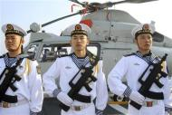 Chinese sailors stand at attention as the Chinese frigate Yancheng comes in to dock at Limassol port, January 4, 2014. REUTERS/Andreas Manolis
