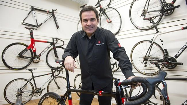 Gervais Rioux poses with the Argon 18 high-performance bicycle in Montreal, Friday, February 13, 2015. A former Canadian Olympian is finally fulfilling his dream of participating in the Tour de France, 25 years after retiring from competitive cycling ??? although he won't personally be racing. THE CANADIAN PRESS/Paul Chiasson