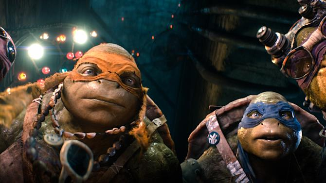 """FILE - This file image released by Paramount Pictures shows characters, from left, Raphael, Michelangelo, Leonardo, and Donatello, in a scene from """"Teenage Mutant Ninja Turtles."""" Moviegoers continued to shell out for """"Teenage Mutant Ninja Turtles,"""" while Sylvester Stallone's """"The Expendables 3"""" was easily out-gunned in its weekend debut. according to studio estimates Sunday, Aug. 17, 2014. (AP Photo/Paramount Pictures, Industrial Light & Magic, File)"""