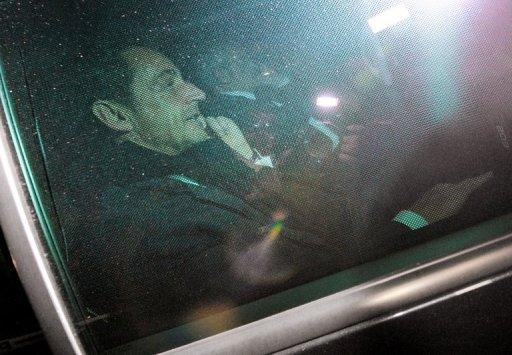 Former French president Nicolas Sarkozy leaves a Bordeaux courthouse in a car on November 22, 2012 at the end of a twelve-hour interrogation by the investigating judges, to respond to charges that his 2007 electoral campaign was financed with funds secured illegally from France's richest woman, Liliane Bettencourt.