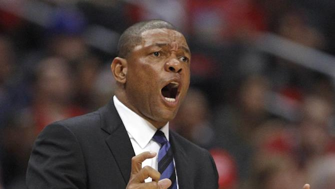 Los Angeles Clippers head coach Doc Rivers disagrees with a referee's call during an NBA basketball game in the second quarter against the Golden State Warriors, Thursday, Oct. 31, 2013, in Los Angeles