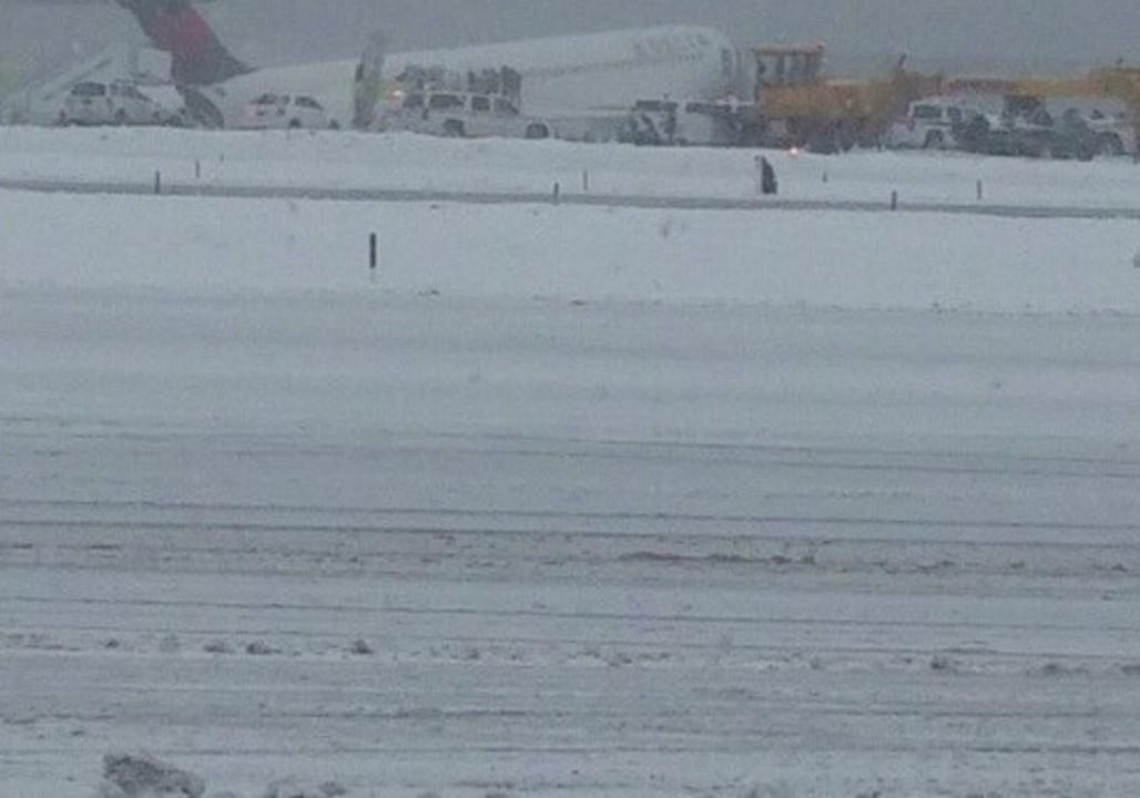 Delta plane skids off runway in snowstorm at New York's LaGuardia