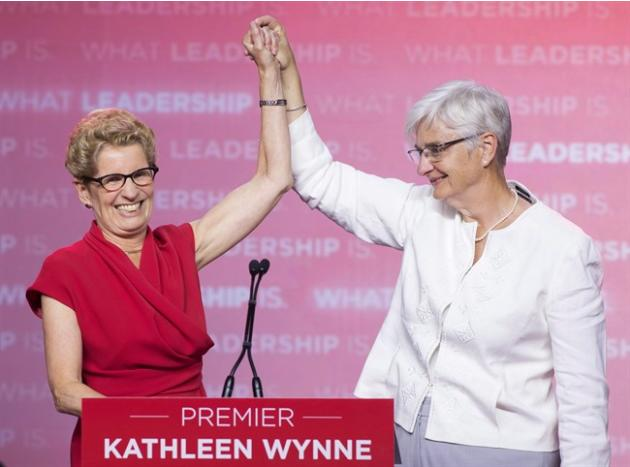 Ontario Liberal Leader Kathleen Wynne celebrates with partner Jane Rounthwaite after winning the Ontario election in Toronto on June 12, 2014. Premier Kathleen Wynne says she has no doubt homophobia m