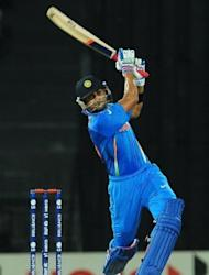 Indian cricketer Virat Kohli plays a shot during their ICC Twenty20 Cricket World Cup match against Afghanistan at the R. Premadasa Stadium in Colombo. India endured a scare from fearless Afghanistan before recording a 23-run win