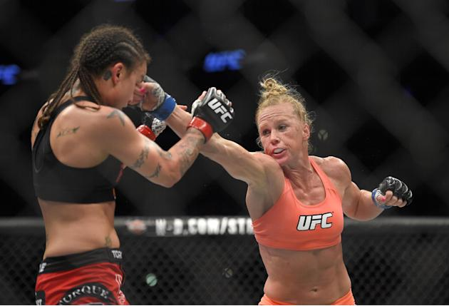 Holly Holm, right, connects with Raquel Pennington during a UFC 184 mixed martial arts bantamweight bout, Saturday, Feb. 28, 2015, in Los Angeles. Holm won by split decision. (AP Photo/Mark J. Terrill