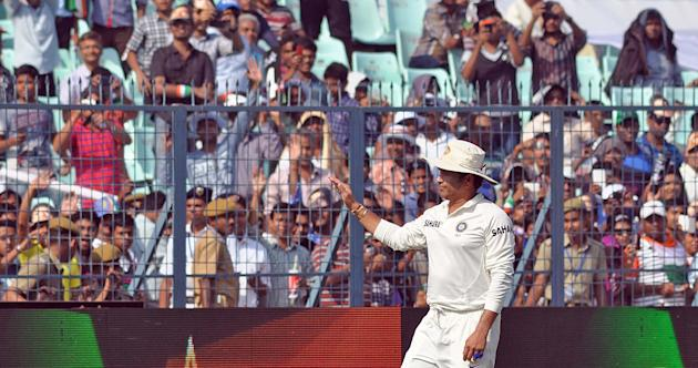Indian cricketer Sachin Tendulkar waves to the public during the 3rd day of the 1st test match between India and West Indies at Eden Gardens, Kolkata on Nov. 8, 2013. (Photo: IANS)