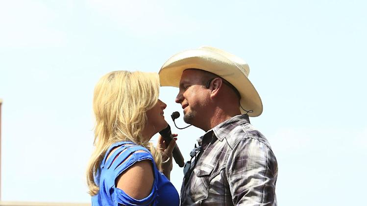 Garth Brooks and Trisha Yearwood performs at the Oklahoma Twister Relief Concert at the Gaylord Family-Oklahoma Memorial Stadium on Saturday, July 6, 2013 in Norman, Okla. (Photo by Alonzo Adams/Invision/AP)