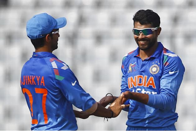 Indian cricketer Ravindra Jadeja, right, celebrates with his teammate Ajinkya Rahane after the dismissal of Afghan cricket player Asghar Stanikzai during the Asia Cup one-day international cricket tou