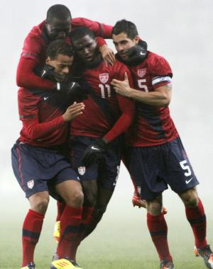 ADDS PLAYERS NAMES - Players of the United States team, Jozy Altidore, top, Timothy Chandler, front left, Edson Buddle (11) and Carlos Bocanegra (5) celebrate their opening goal during their international friendly soccer match with Slovenia in Ljubljana, Slovenia, Tuesday, Nov. 15, 2011. (AP Photo/Filip Horvat)