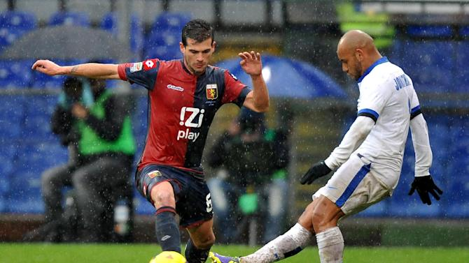 Genoa's Stefano Sturaro, left, vies for the ball with Inter's Jonathan of Brazil, during a Serie A soccer match at Genoa's Luigi Ferraris Stadium, Italy, Sunday, Jan. 19 2014