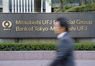 Japan's Mitsubishi UFJ Financial Group posted an annual profit surge of 68.3 percent on lower credit costs, bond trading gains and a conversion of its stake in Morgan Stanley