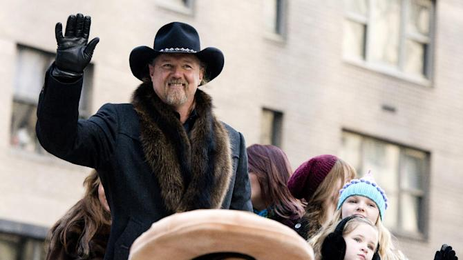 FILE - In this Thursday, Nov. 22, 2012 file photo, Trace Adkins rides a float in the Macy's Thanksgiving Day Parade in New York. Trace Adkins wore an earpiece decorated like the Confederate flag when he performed for the Rockefeller Center Tree Lighting on Nov. 28, but he said he didn't mean to offend anyone by wearing it. (AP Photo/Charles Sykes, File)