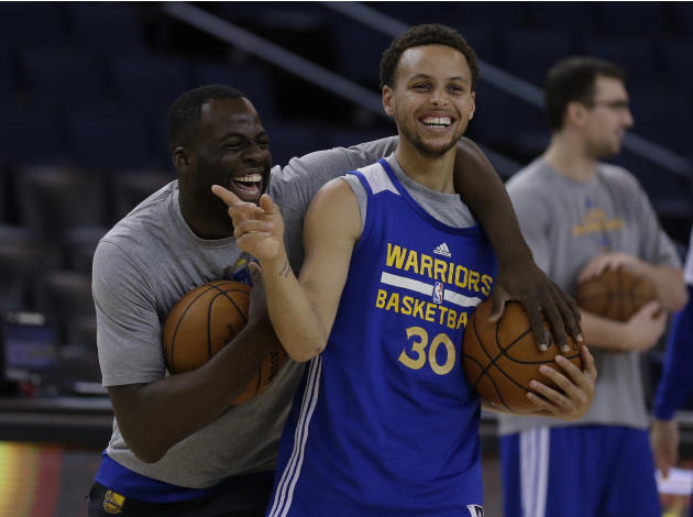 Golden State Warriors' Draymond Green, left, and Stephen Curry laugh during an NBA basketball practice, Wednesday, June 3, 2015, in Oakland, Calif. The Warriors host the Cleveland Cavaliers in Gam