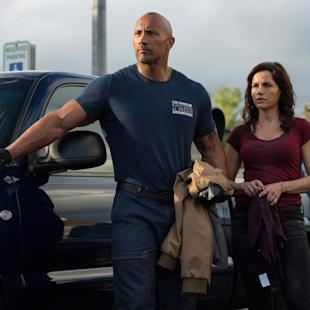 """This photo provided by Warner Bros. Pictures shows Dwayne Johnson, left, as Ray, and Carla Gugino as Emma, in a scene from the action thriller, """"San Andreas."""" The movie releases in theaters on May 29, 2015.  (Jasin Boland/Warner Bros. Pictures via AP)"""