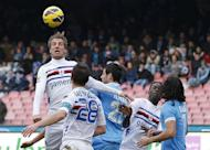Sampdoria forward Maxi Lopez (L) heads the ball during the Italian Serie A football match against Napoli in San Paolo Stadium on February 17, 2013 in Naples. Sampdoria put the brakes on Napoli's Serie A title ambitions by holding the Neapolitans to a scoreless draw