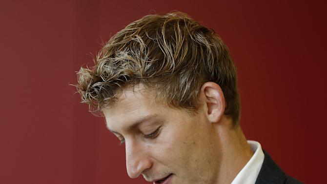 Leverkusen's top scorer Stefan Kiessling waits for the beginning of a meeting of the sports tribunal of the German soccer federation in Frankfurt, Germany, Monday, Oct. 28, 2013. Kiessling had scored a ghost goal through a hole in the net giving his team a 2-0 lead in the German Bundesliga soccer match between Hoffenheim and Leverkusen on Oct. 18. Hoffenheim demands for a re-match