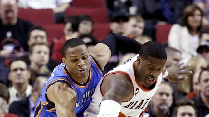 Oklahoma City Thunder guard Russell Westbrook, left, knocks the ball away from Portland Trail Blazers guard Wesley Matthews during the first half of an NBA basketball game in Portland, Ore., Friday, Feb. 27, 2015. (AP Photo/Don Ryan)