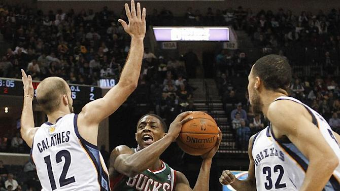 Milwaukee Bucks guard Brandon Knight (11) goes to the basket against Memphis Grizzlies guard Nick Calathes (12) and forward Tayshaun Prince, right, in the first half of an NBA basketball game on Saturday, Feb. 1, 2014, in Memphis, Tenn
