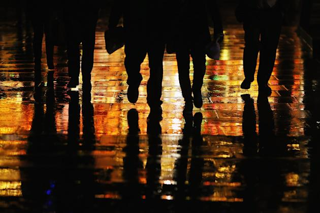 People walk down the Southbank in the rain in London. Britain is once again bracing for more floods and heavy rain (Dan Kitwood/Getty Images)
