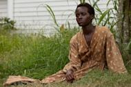 "This image released by Fox Searchlight shows Lupita Nyong'o in a scene from ""12 Years a Slave."" Nyong'o is nominated for an Oscar for her performance by an actress in a supporting role. (AP Photo/Fox Searchlight, Francois Duhamel, file)"