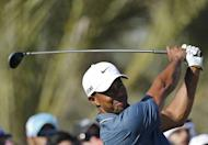 Tiger Woods of the US plays a shot during the second round of the Abu Dhabi Golf Championship at the Abu Dhabi Golf Club in the Emirati capital on January 18, 2013. Woods struggled to find his game as he bogeyed four of the first five holes. He eventually missed the cut