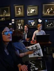 People attend an auction of photographs taken by late celebrity photographer Milton Greene on in Warsaw, Poland. Fans snapped up over 230 photos of the tragic star and other big Hollywood names for $740,000