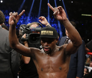 Floyd Mayweather Jr. celebrates after his welterweight title fight against Manny Pacquiao. (AP)