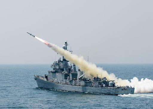 A South Korean navy vessel fires an anti-ship missile during a naval drill off the east coast of South Korea on May 19, 2015