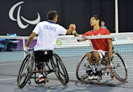 Japan's Shingo Kuneida (R) shakes hands with France's Stephane Houdet after Kuneida won the men's singles wheelchair tennis gold medal final during the London 2012 Paralympic Games at the Olympic Park in east London