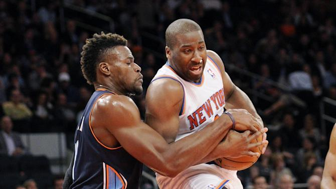 Charlotte Bobcats' Jeff Adrien, left, ties up New York Knicks' Raymond Felton during the second quarter of an NBA basketball game Tuesday, Nov. 5, 2013, at Madison Square Garden in New York