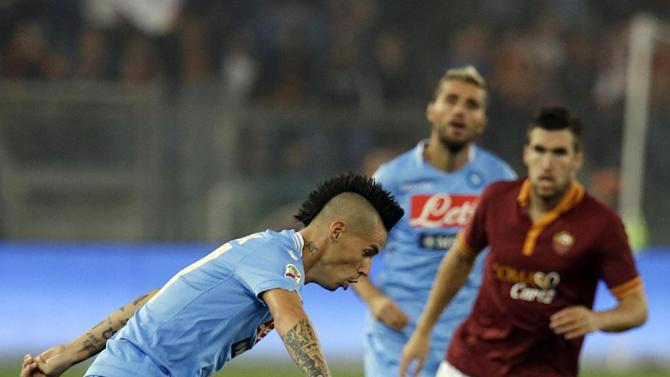 Napoli's Marek Hamsik of Slovakia controls the ball during a Serie A soccer match between AS Roma and Napoli at Rome's Olympic stadium, Friday, Oct. 18, 2013
