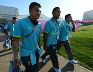 Brazil's Olympic football team players (from L-R) Thiago Silva, Juan Jesus and Alex Sandro are pictured after buying souvenirs at the Olympic Village in London on July 22, 2012 five days before the opening ceremony of the Olympic games. AFP PHOTO / KHALED DESOUKI