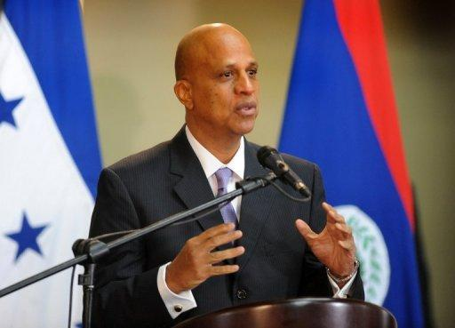 "Belize's Prime Minister Dean Barrow speaks to the media in Tegucigalpa, Honduras, on November 7, 2012. Belize has reached a deal in principle with creditors to restructure about half of its unpaid debt after ""long and arduous"" talks, allowing the country to avoid default, officials said Friday."