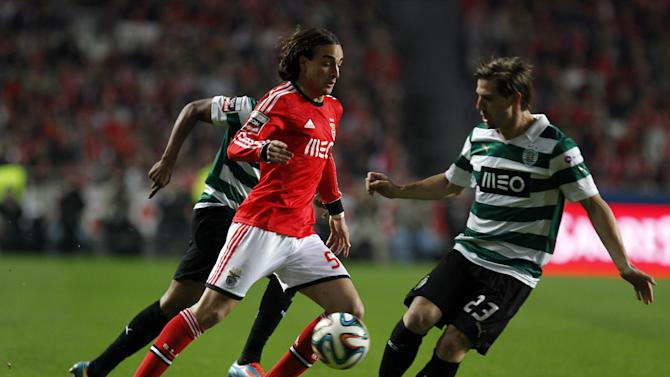 Benfica's Lazar Markovic, from Serbia, fights for the ball with Sporting's Adrien Silva, right, from France, during the Portuguese league soccer match between Benfica and Sporting at Benfica's Luz stadium, in Lisbon, Tuesday, Feb. 11, 2014