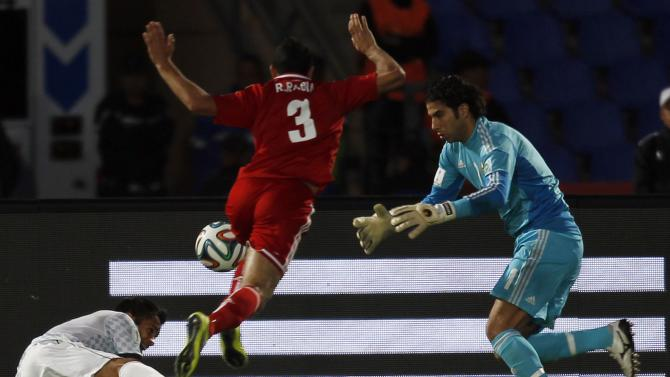 Arellano of Mexico's Monterrey fights for the ball with Rabia and Ekramy of Egypt's Al Ahly during their 2013 FIFA Club World Cup football match for fifth place in Marrakech