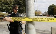 A police officer closes off the scene near the Canada War Memorial following a shooting incident in Ottawa October 22, 2014. REUTERS/Chris Wattie