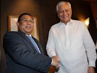 Philippine Foreign Secretary Albert del Rosario (right) shakes hands with his Myanmar counterpart U Wunna Maung Lwin during a meeting in Manila. The Philippines has sought Myanmar's support in its maritime territorial dispute with China as the foreign ministers of the two Southeast Asian countries met in Manila