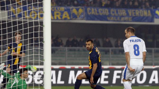 Inter Milan's Palacio shoots to score against Hellas Verona during their Italian Serie A soccer match in Verona