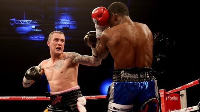 Boxing - Burns survives big scare to defend title