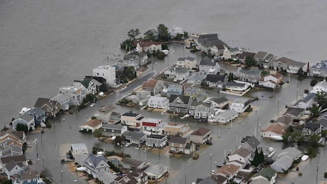 FILE - This Tuesday, Oct. 30, 2012 file photo made available by the New Jersey Governor's Office shows flooding on the bay side of Seaside, N.J., after Superstorm Sandy made landfall. The unprecedented storm surge created by the storm caused the National Oceanic and Atmospheric Administration to increase the number of storm surge forecasters at the National Hurricane Center starting with the 2013 Atlantic Hurricane season. They will also provide potential storm surge hazards at least 48 hours before the onset of tropical storm or gale-force winds. (AP Photo/New Jersey Governor's Office, Tim Larsen)